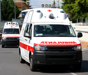 Two ambulances in the street run fast to the place of accident
