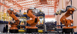 Robots welding in a production line - 65895205