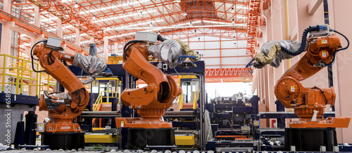 Leinwanddruck Bild Robots welding in a production line