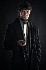 young man in the image of Sherlock isolated on black