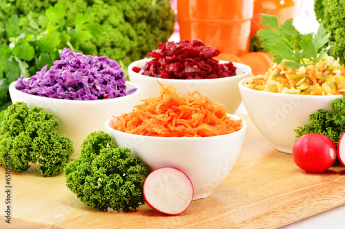 Composition with four vegetable salad bowls