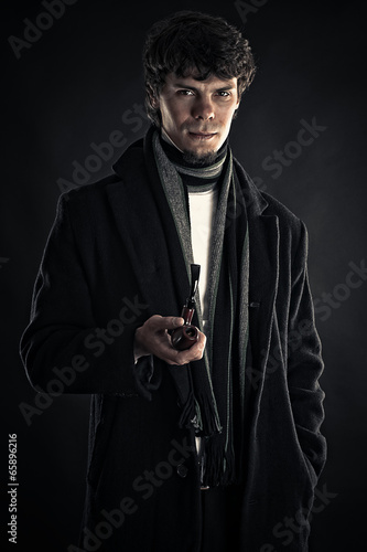 Poster young man in the image of Sherlock isolated on black