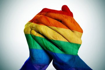 man hands patterned as the rainbow flag