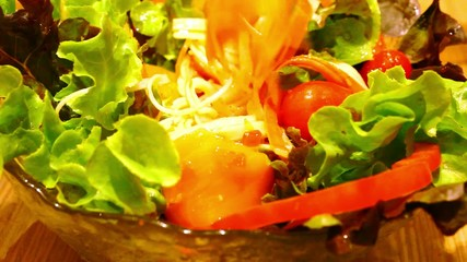 Pouring sauce and eating salad with salmon. Macro fast motion