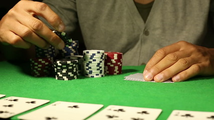 Anonymous male going all in during a Poker game