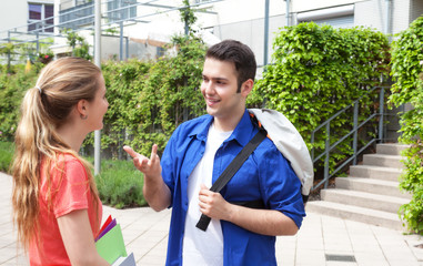 Two students talking on campus