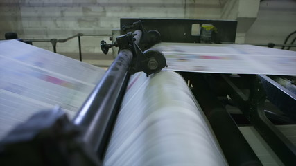 Cutting paper folds the newspaper