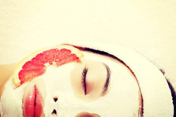 Attractive young woman with fruit mask