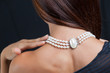Woman with pearl necklace on her neck - 65899269