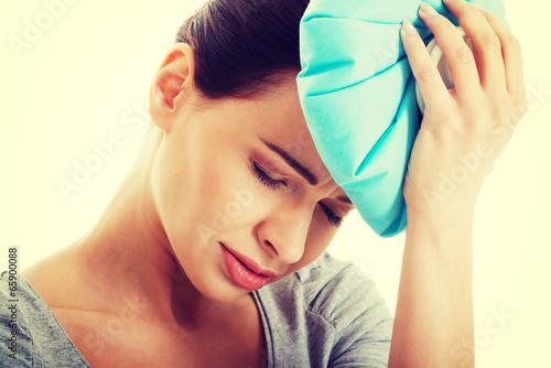 Young beautiful woman is haveng a headache.