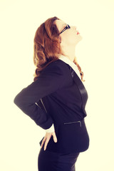 Businesswoman with back pain.