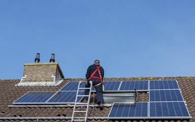 man making construction with solar panels