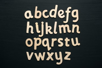 Wooden letters of the alphabet on a blackboard