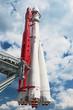 Space transport rocket against blue sky