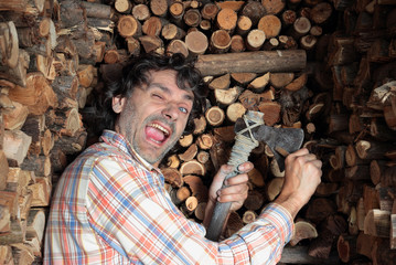 happy woodcutter sharpening the axe