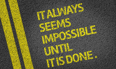It Always Seems Impossible Until It Is Done written on the road
