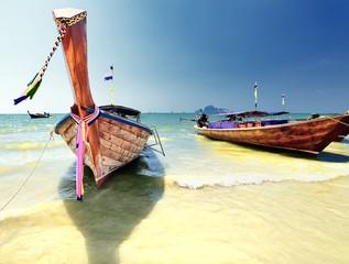 Longtail boat on ropical beach in Krabi, Andaman Sea, Thailand