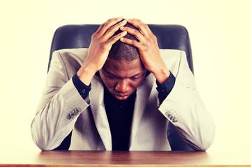 Sad, tired or depressed businessman