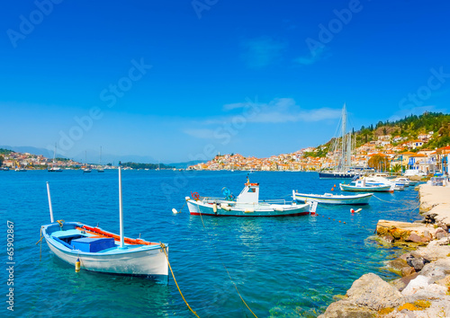 Traditional fishing boats at Poros island in Greece - 65902867
