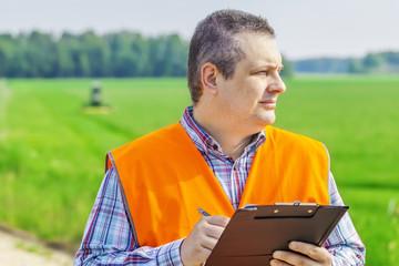 Farmer foreman near the field