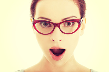 Young surprised woman in eyeglasses.