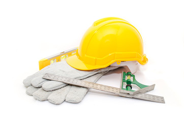 isolated yellow hard hat with tools on white