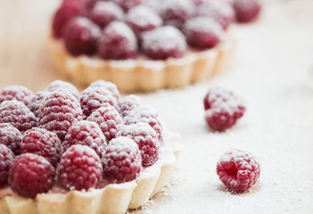 Raspberry tart on wooden table