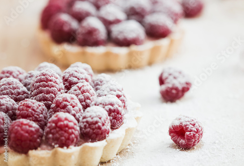 Raspberry tart on wooden table - 65904857