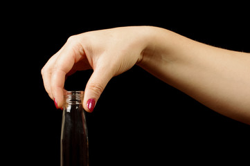 Female hand holding vodka bottle