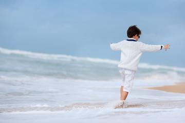 Six years old boy playing on atlantic beach