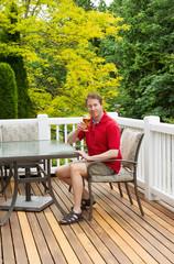 Man enjoying nice day outdoors while drinking beer