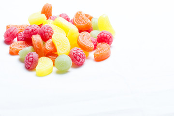 close up colorful candy isolated on white