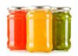 Jars of fruity jams isolated on white background