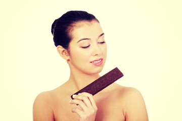 Pretty happy smiling woman eating chocolate waffle