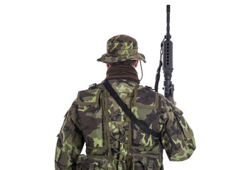 Soldier in camouflage and modern weapon M4.
