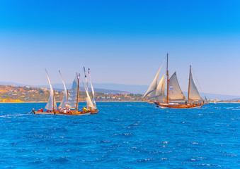 several classic wooden sailing boats in Spetses island in Greece