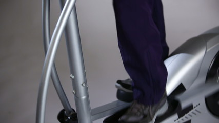 Man exercising on a Elliptical Trainer