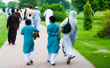 Muslim family going for Eid prayers