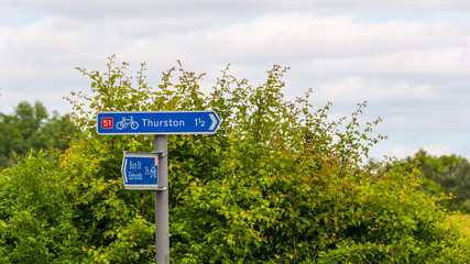 Signpost for cycle lane, Thurston, Bury St Edmunds, Suffolk