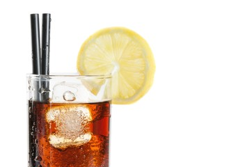 glass of fresh coke with straw with lemon slice on top