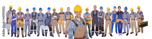 Leinwandbild Motiv Construction Worker With Colleagues Over White Background