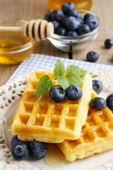 Waffles with syrup and blueberries