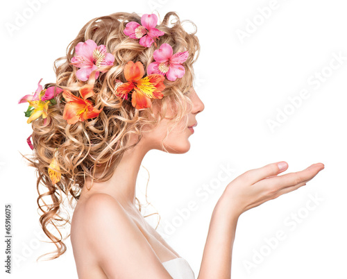 Beauty girl with flowers hairstyle and open hands