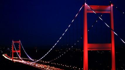 Istanbul FSM Bridge with red lighting at night