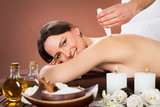 Woman Receiving Microdermabrasion Therapy At Beauty Spa poster