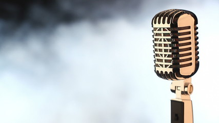 Vintage microphone on white smoke background