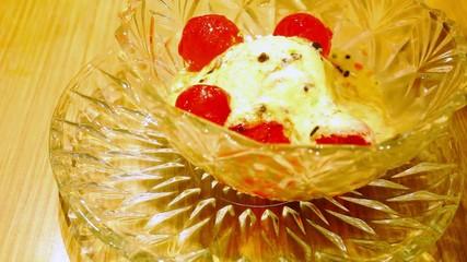 Eating vanilla ice cream ball with jelly. Macro video