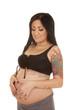 pregnant woman tattoos bikini top heart belly look down