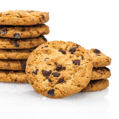 A stack of chocolate chip cookies isolated on a white background