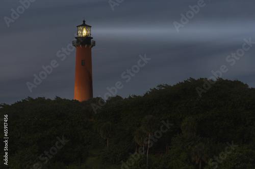 Foto op Canvas Vuurtoren / Mill Lighthouse light beam at night